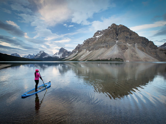 Paddleboarding at Bow Lake, Banff National Park, Alta.