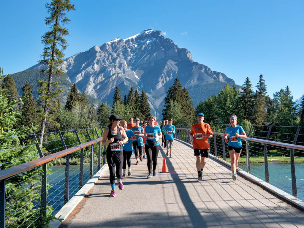 Participants run in the mountaints at the Banff Marathon