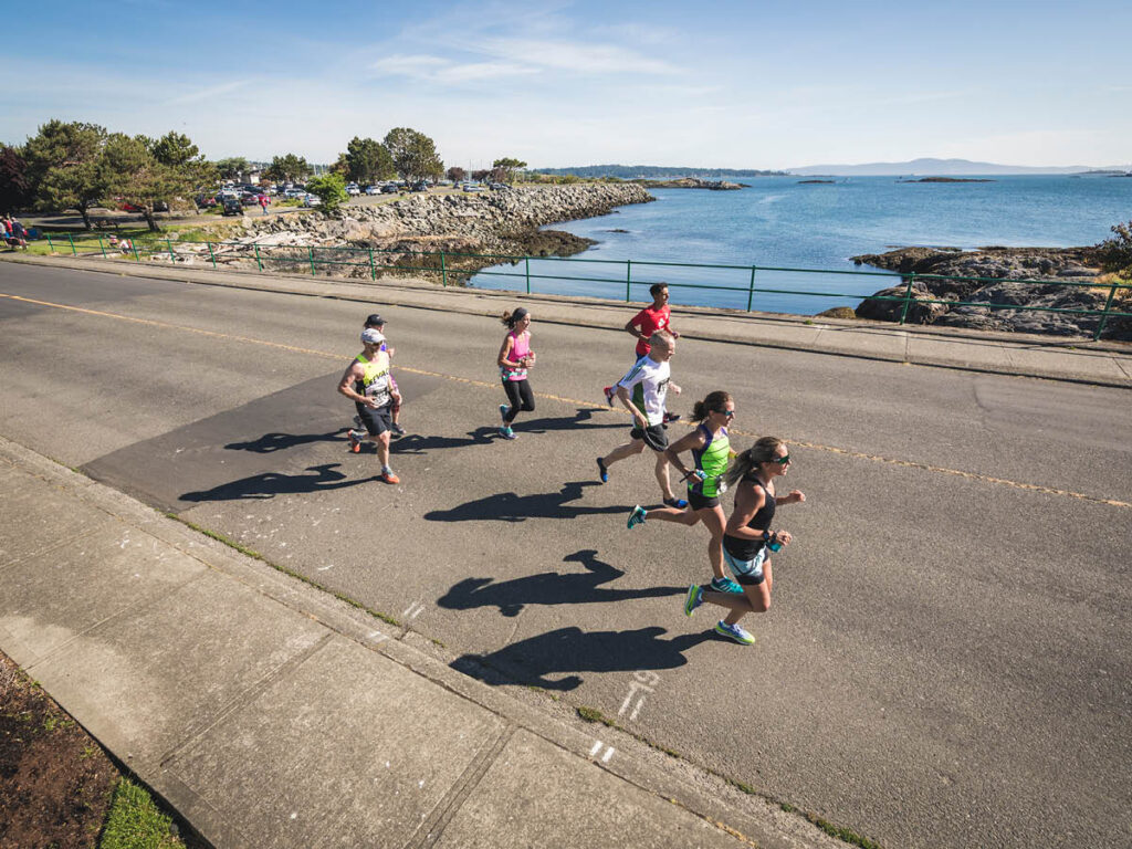 Runners near the water at the Oak Bay Half Marathon
