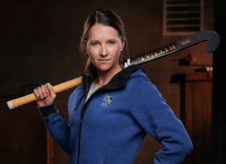 Kate Wright poses with her field hockey stick